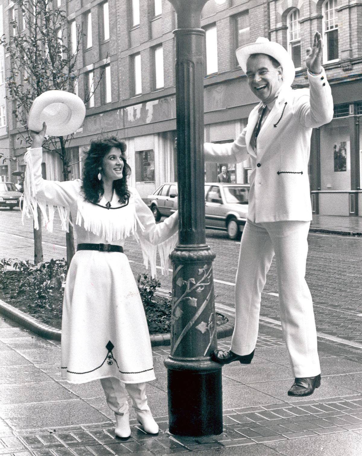 Ruth Johnson, poses as crackshot Annie, outside the Grand Theatre with Jerry Hobbs, who played Frank Butler