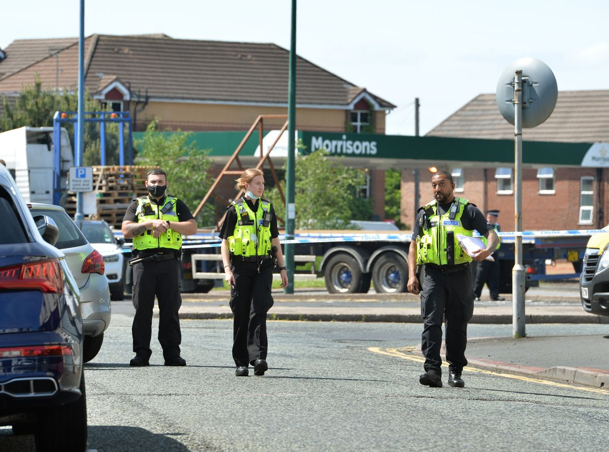 Police at the scene in Upper High Street, Wednesbury