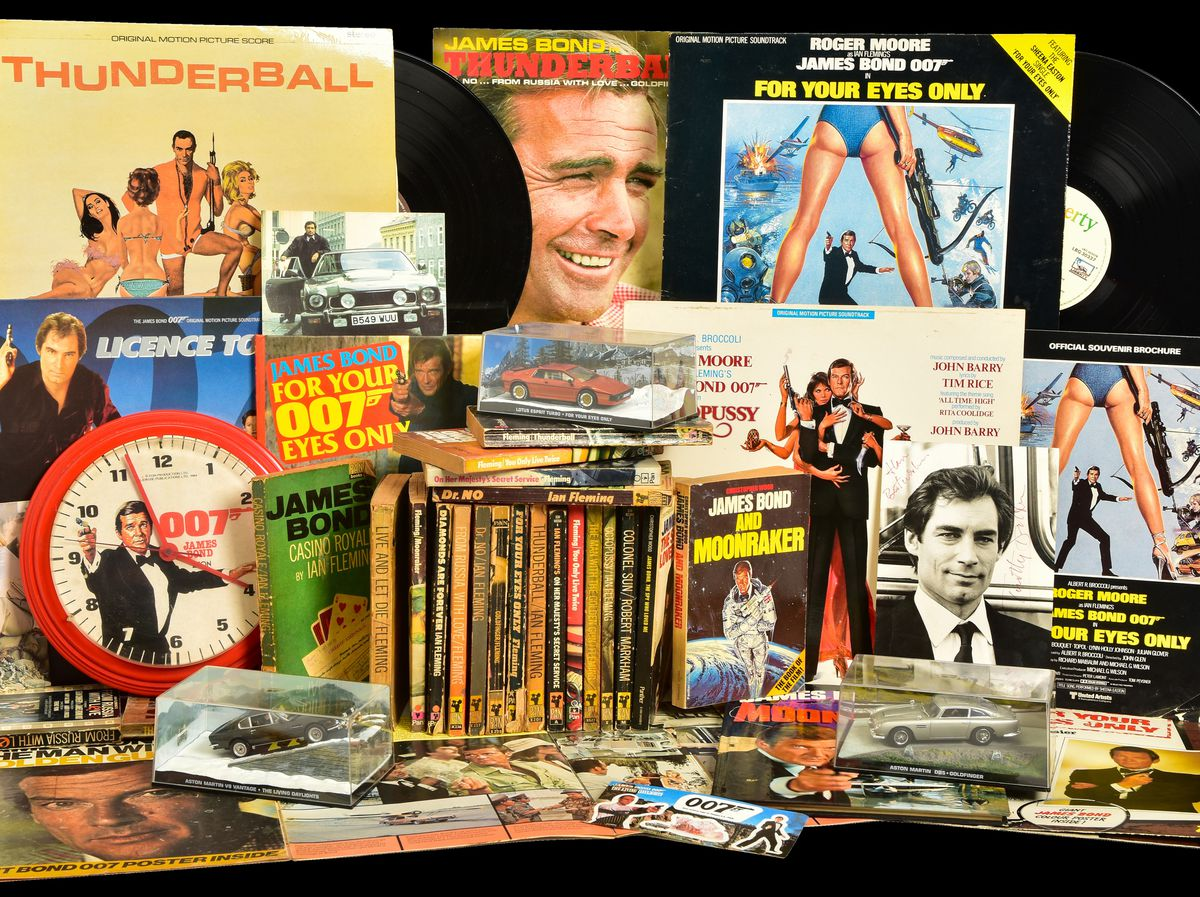 A collection of James Bond posters, books and other memorabilia