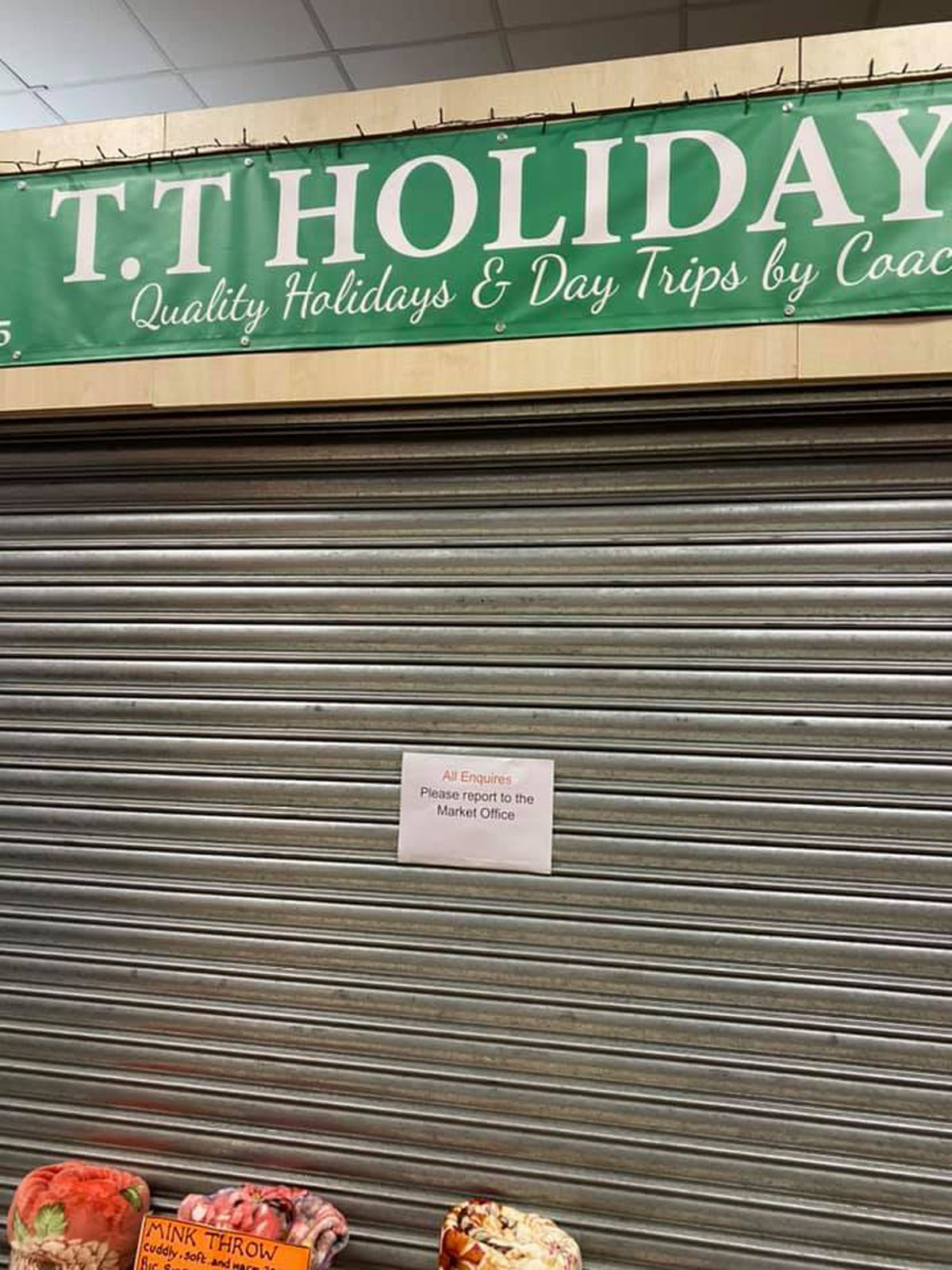 The closed up stall with a notice on asking people to go instead to the market office. Image: Facebook