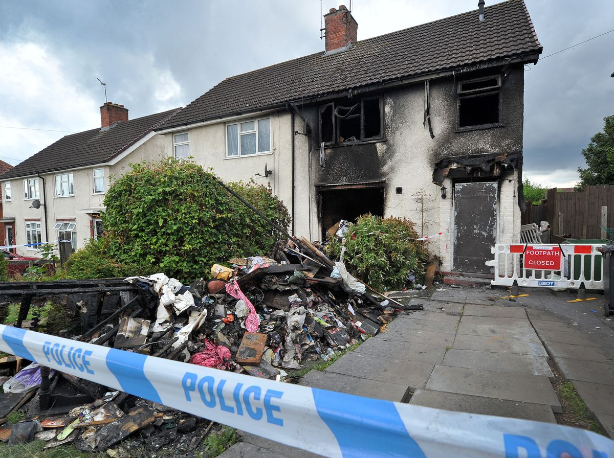 The house remained cordon off with police tape on Monday