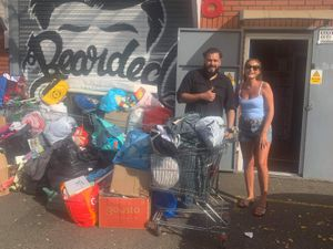 Jess Cope delivers donations made by Whittington residents to aid Afghan refugees to the Bearded Brothers in Smethwick.