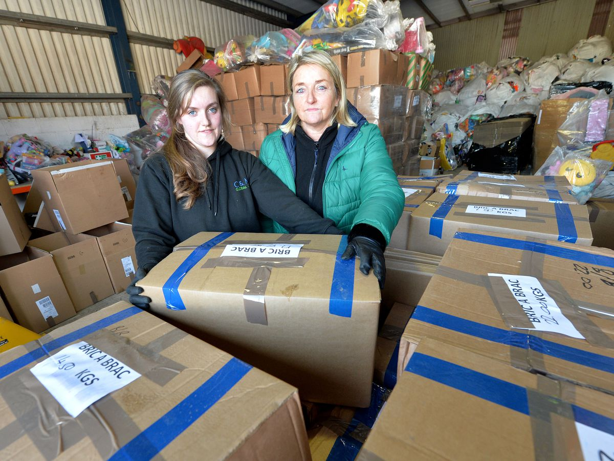 Charlotte Stokes and Maxine Sault from C & M Global with stock waiting to be delivered
