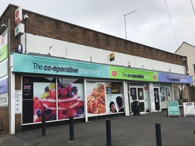 Masked axeman steals cash in daylight Co-op raid in Wolverhampton