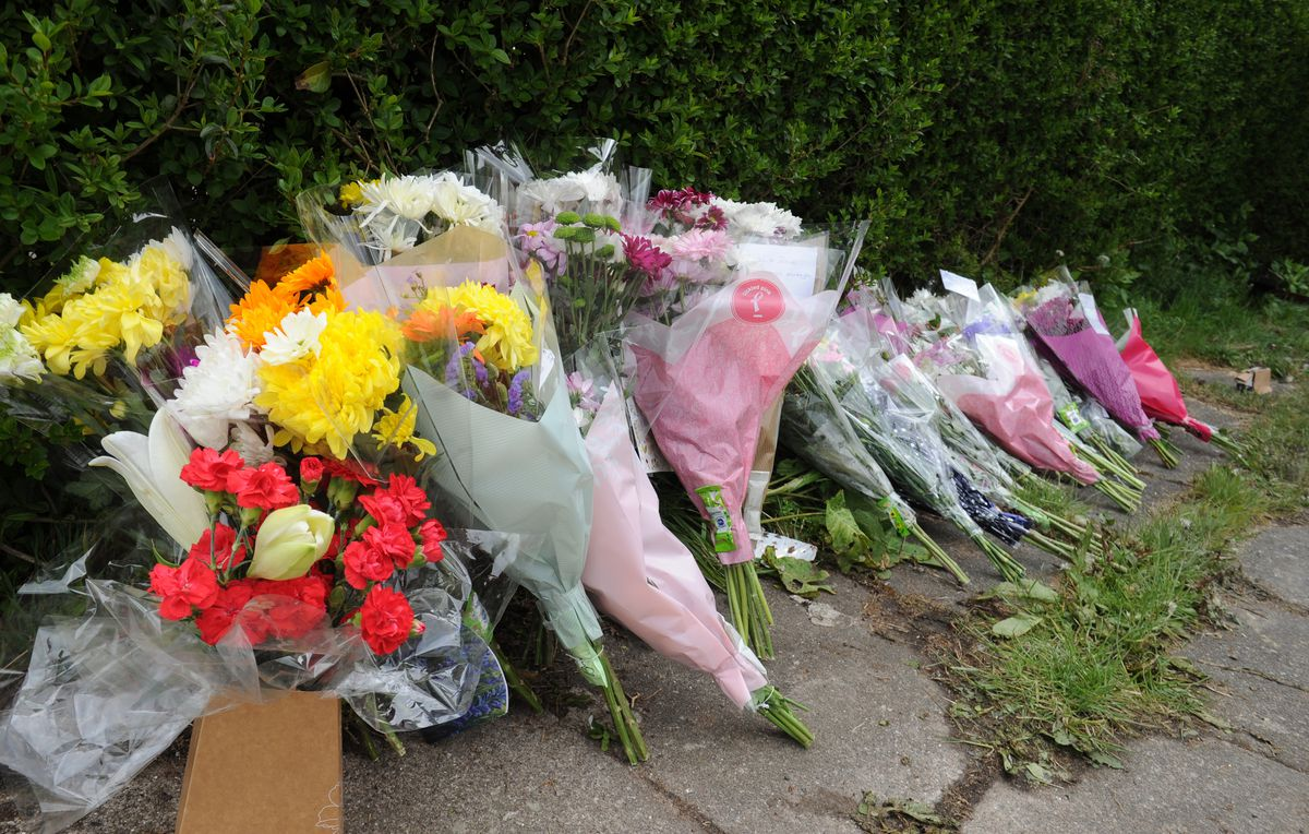 Tributes left at the scene of a fatal house fire, at Beacon Lane, Sedgley.