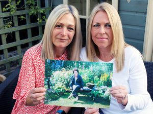 Jennie Davies and Jackie Harrison with a picture of Christine Harrison.