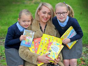 Emma with her two children Darcie and Evie at Cotwall End Primary School in Dudley