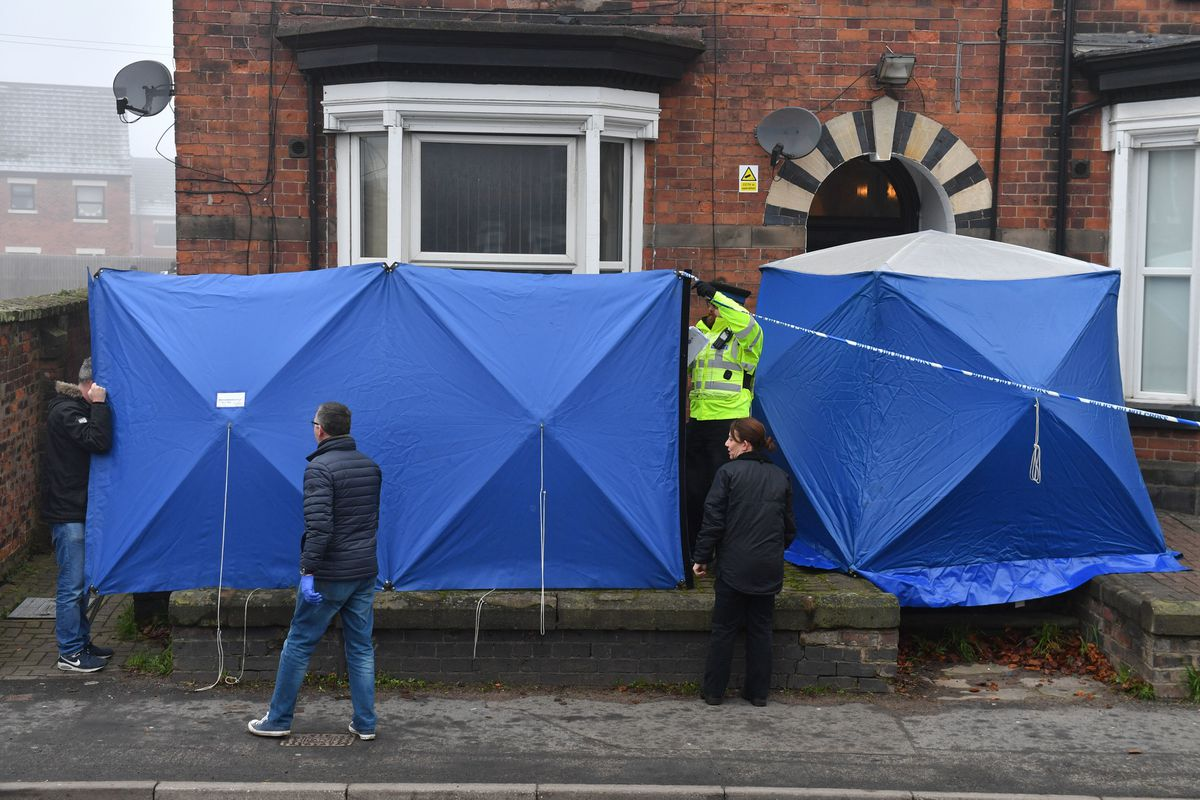 Police setting up barriers to maintain the integrity of the site for gathering evidence at a three-storey block of flats in Woverhampton Road, Stafford, where a property is being searched by police following yesterday's stabbing attacks in London. Credit: Jacob King/PA Wire.