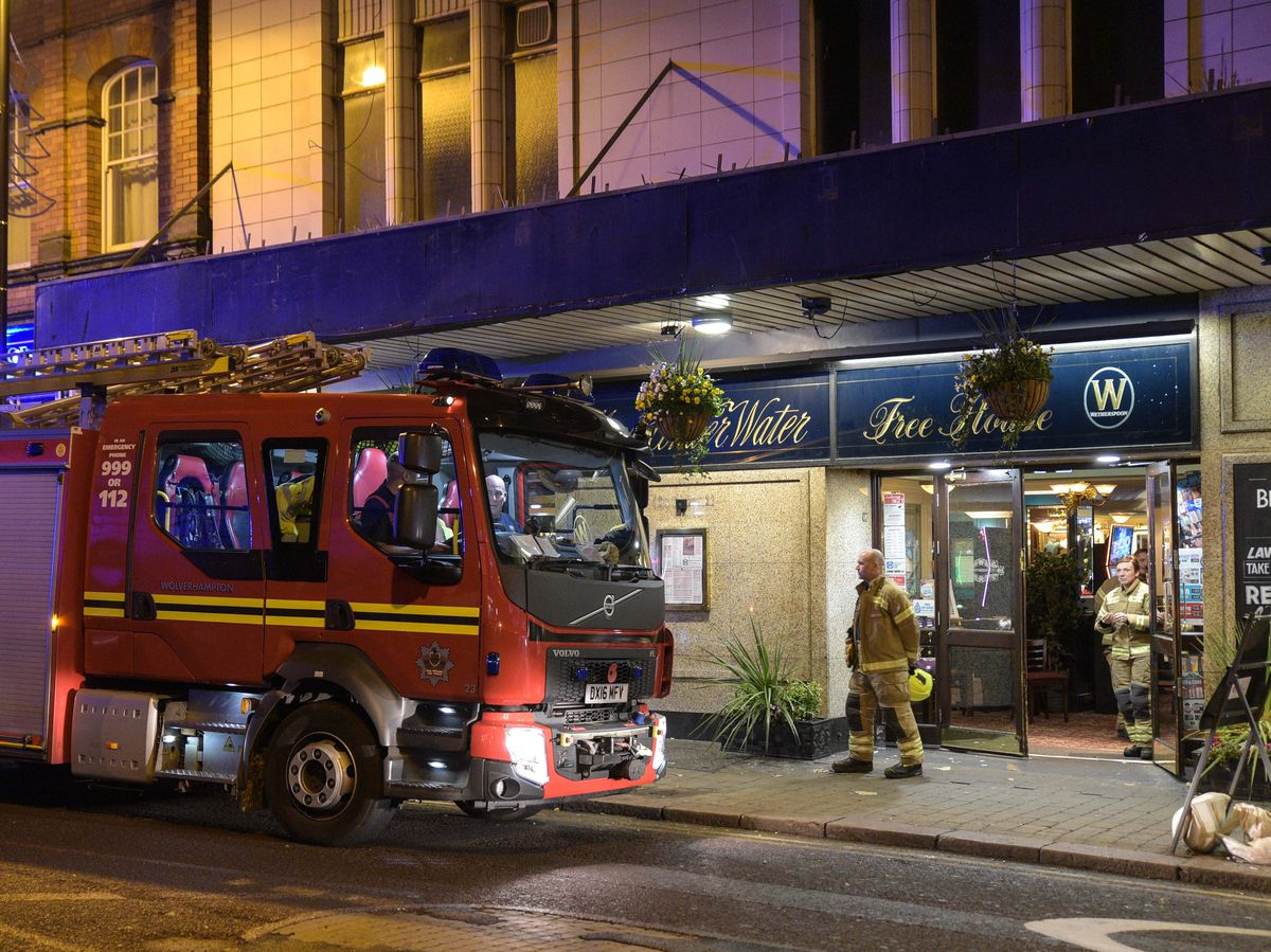 Fire crews outside The Moon Under Water pub. Photo: SnapperSK