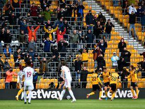 Wolverhampton Wanderers' Nelson Semedo celebrates in front of the fans