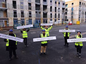 Councillor Waseem Zaffar and others displaying the new street names at the residential scheme