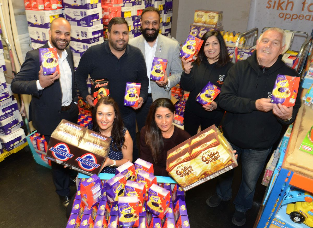 .Pictured front, L-R: Lucy Russon and Sonia Dwaliwal along with staff and volunteers at the Sikh Toy Appeal, Moorfield Works Upper Villiers Street, Wolverhampton, as they take dilivery of over a thousand Easter eggs