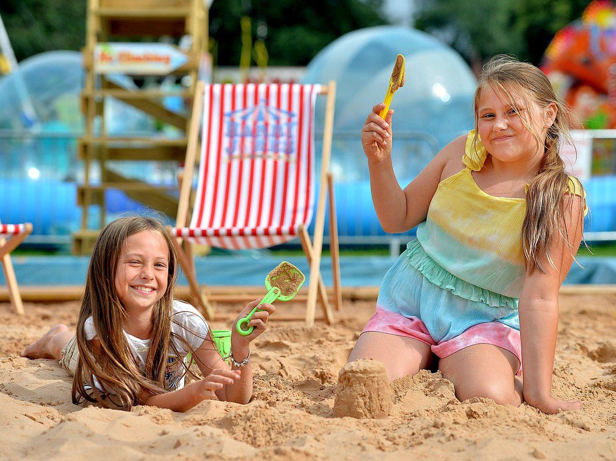 Luella Humphreys and Lola Moran enjoy the sand at West Park