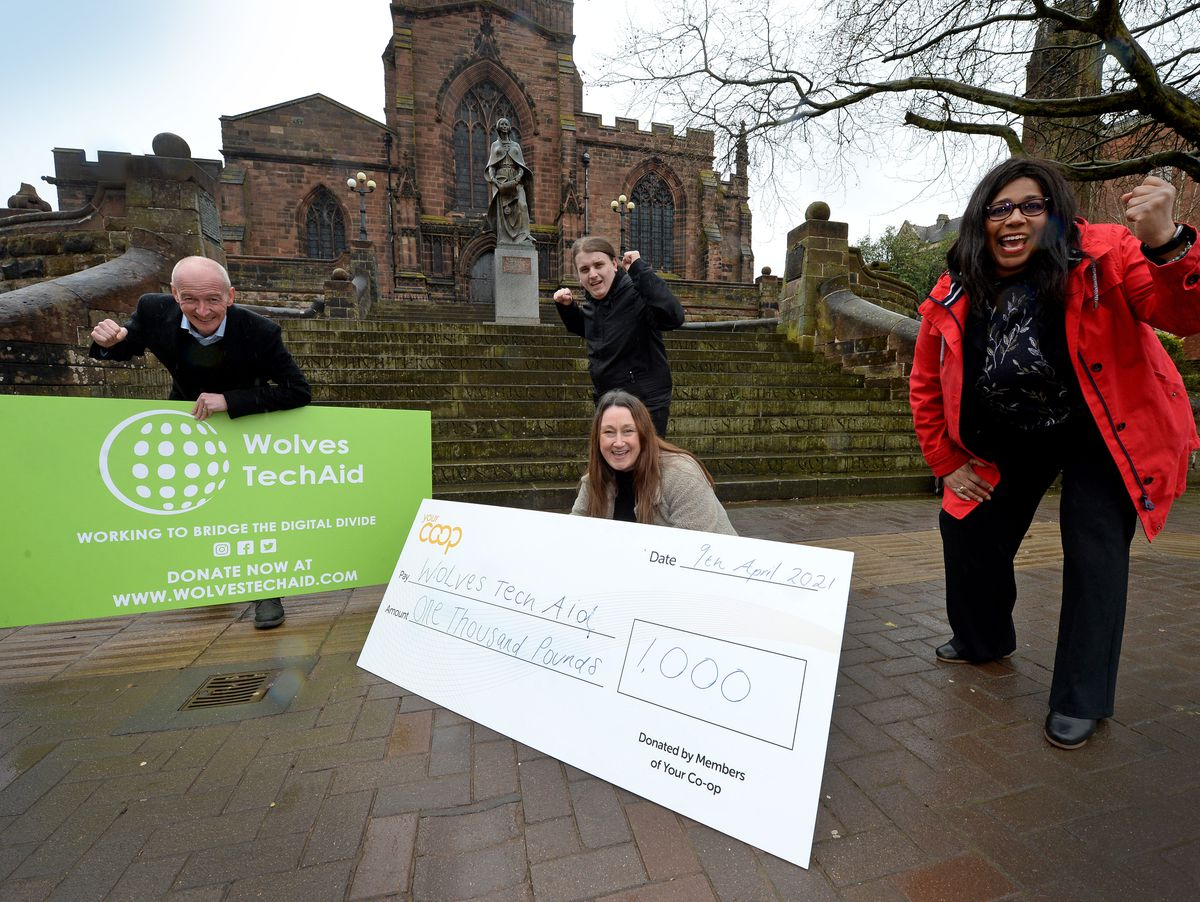Pat McFadden MP, Kallum Wright, head of film department at LearnPlay Foundation Ltd, with The Midcounties Co-operative's Councillor Olivia Birch and Marnie Richards and the £1000 cheque for Wolves Tech Aid.
