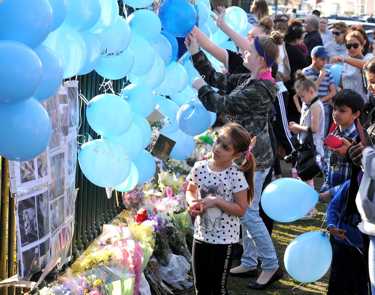 Shocked residents tie balloons to the West Park fence in memory of Viktorija