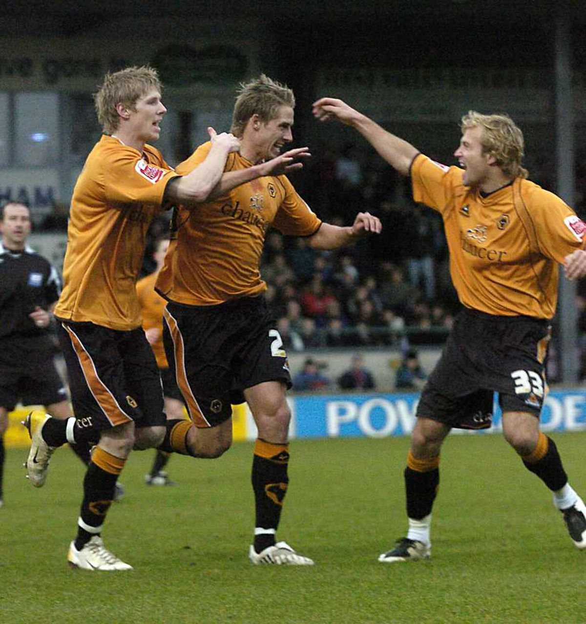Blonde attraction - Edwards celebrates his debut goal with Andy Keogh and Michael Gray