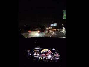 Alessio Deledda driving a Lamborghini in traffic