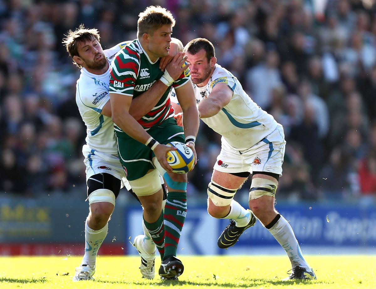 Leicester's Ed Slater is tackled by Aly Muldowney and Tom Hayes of Exeter