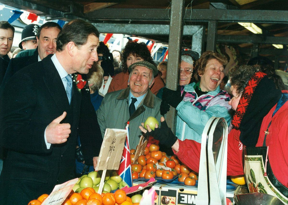 Prince Charles shares a joke with some of the people he met in Dudley Market Place during his visit in  February 1996.