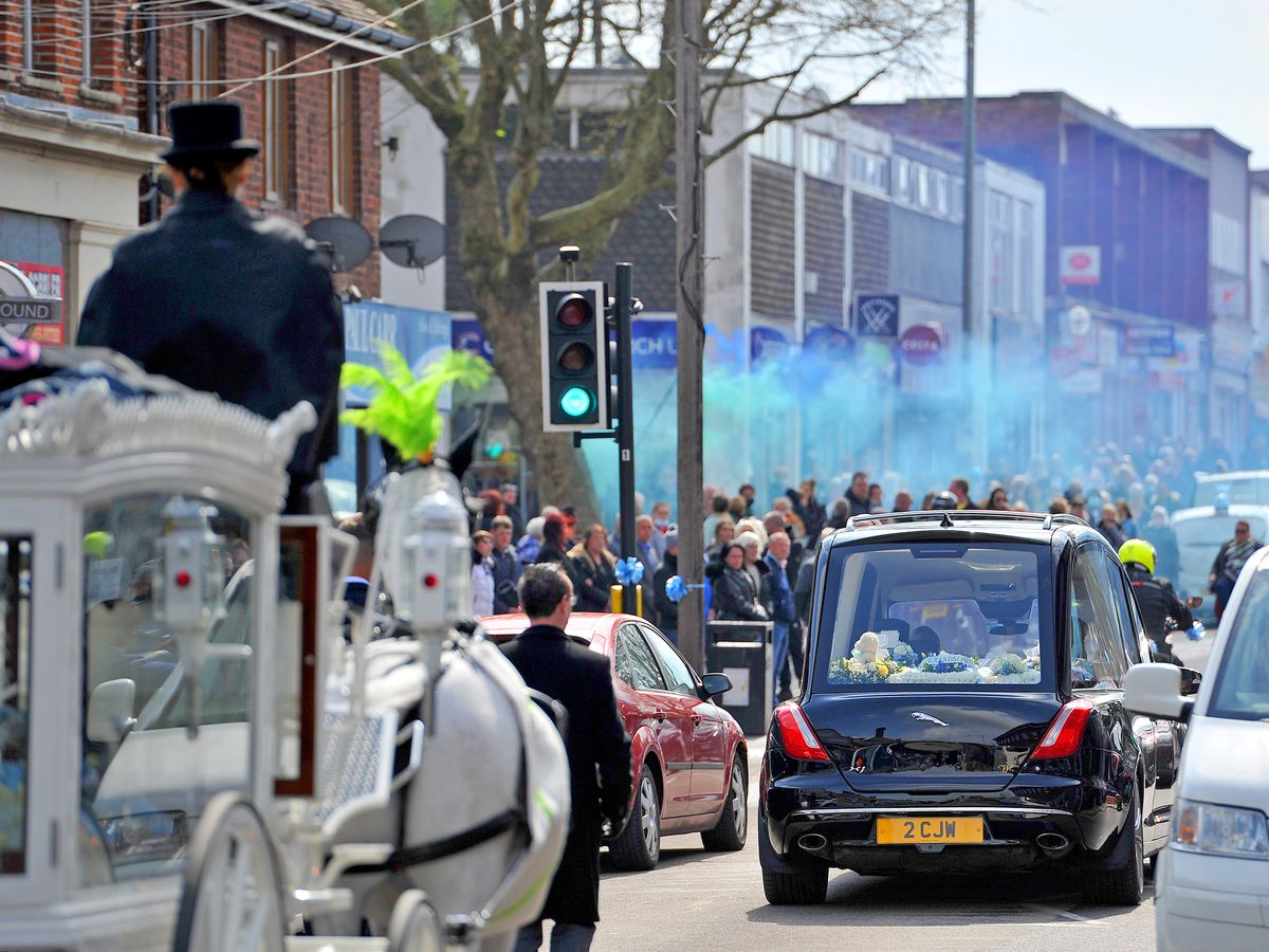 The funeral procession for baby Ciaran Morris in Brownhills High Street. A blue flare is let off.