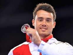 Climbing the walls: Kristian Thomas helping to keep seated nation moving