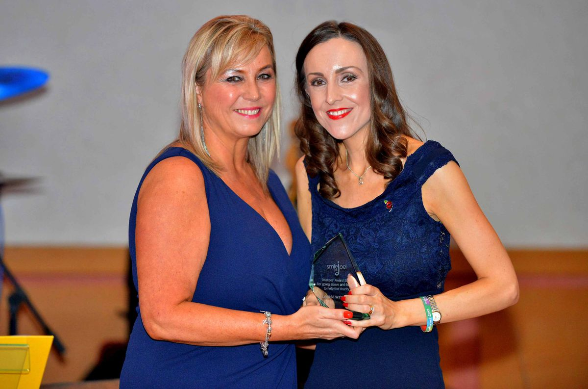 Louise Harrison presents an award to Louise Withers in recognition for the help she has given to Suzy and the charity