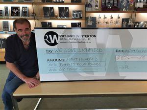 Simon Price receiving the cheque from Richard Winterton
