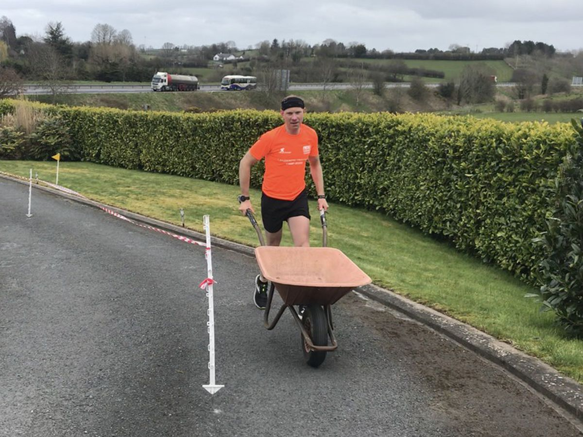 Keith Clarke from Dungannon, Co Tyrone ran a marathon in his driveway while pushing a wheelbarrow