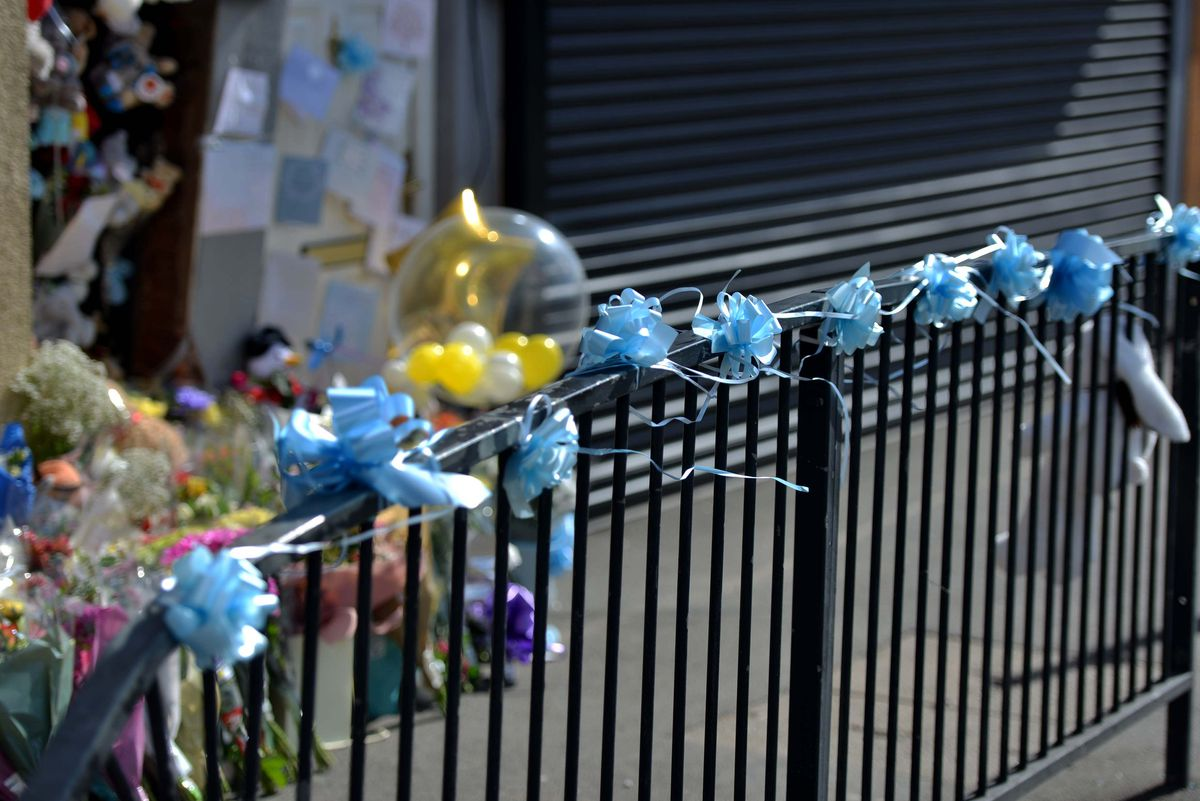 Blue ribbons left at the scene of the crash in High Street, Brownhills