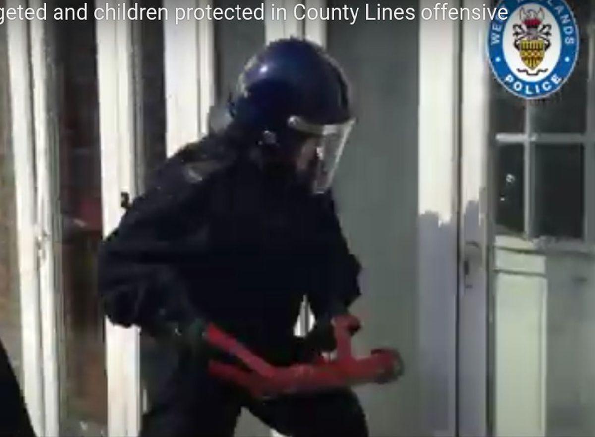 Police raiding a drugs den in Birmingham