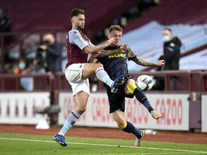 Aston Villa's Henri Lansbury (left) and Stoke City's Josh Tymon