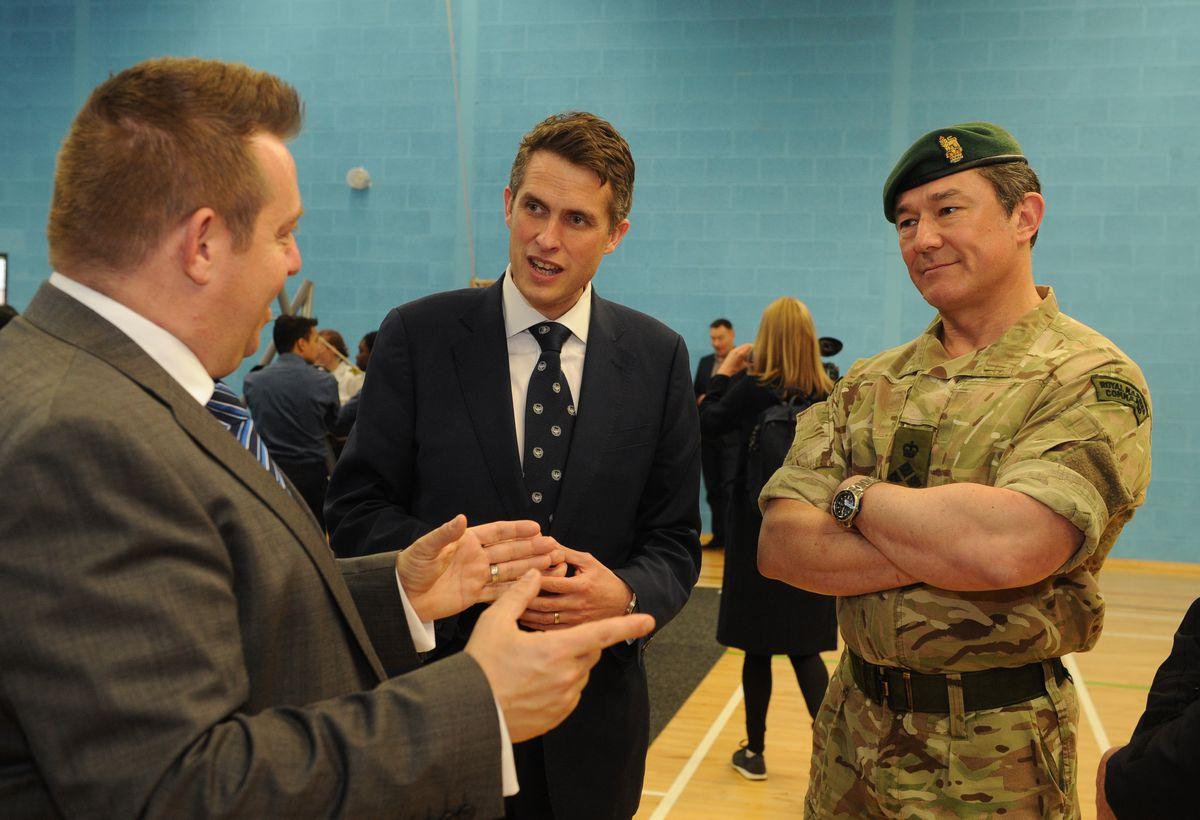 Defence Secretary Gavin Williamson with headteacher Mike Smith, and Brigadier Dave Kassapian