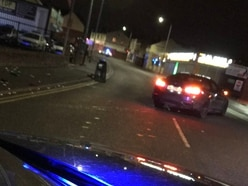Stolen BMW crashes into wall in Dudley after police chase