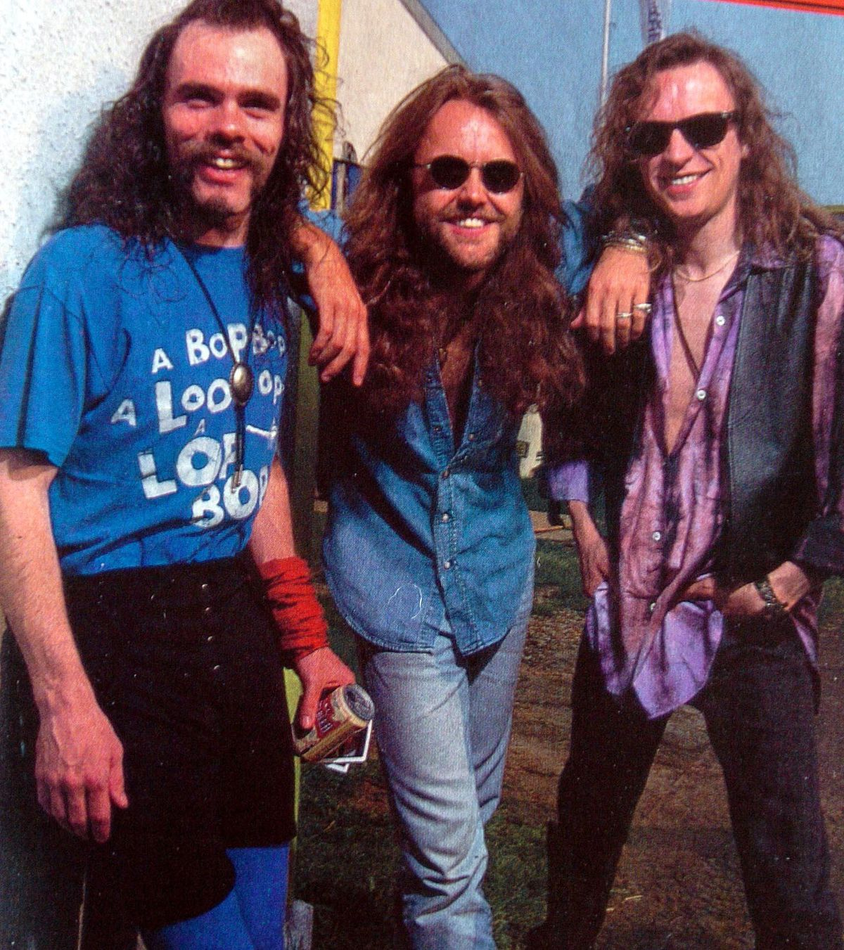 Diamond Head's former member Sean Harris, left, and frontman Brian Tatler, right, with Metallica's Lars Ulrich in 1993