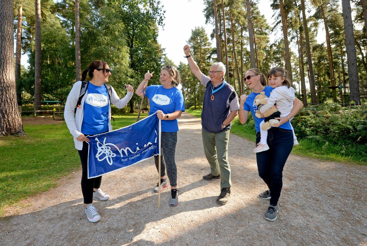 Pc Claire Bond, second from left, continues her charity walk for Mind, at Birches Valley Forest Centre, Rugeley, with Laura Turner, High Sheriff of Staffordshire Charles Bagot Jewitt, and Catherine Edney, with her three year old daughter, Libby