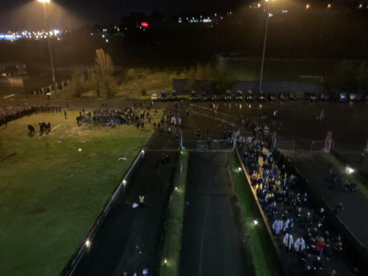 Wolves fans were forced to wait in a field after the match had kicked off. Photo: Lee Tompson