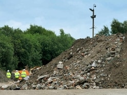 Boss faces jail over illegal eyesore waste mountain