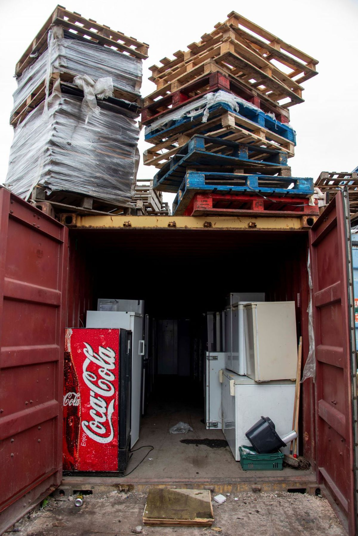 Stacked pallets and discarded fridges and freezers
