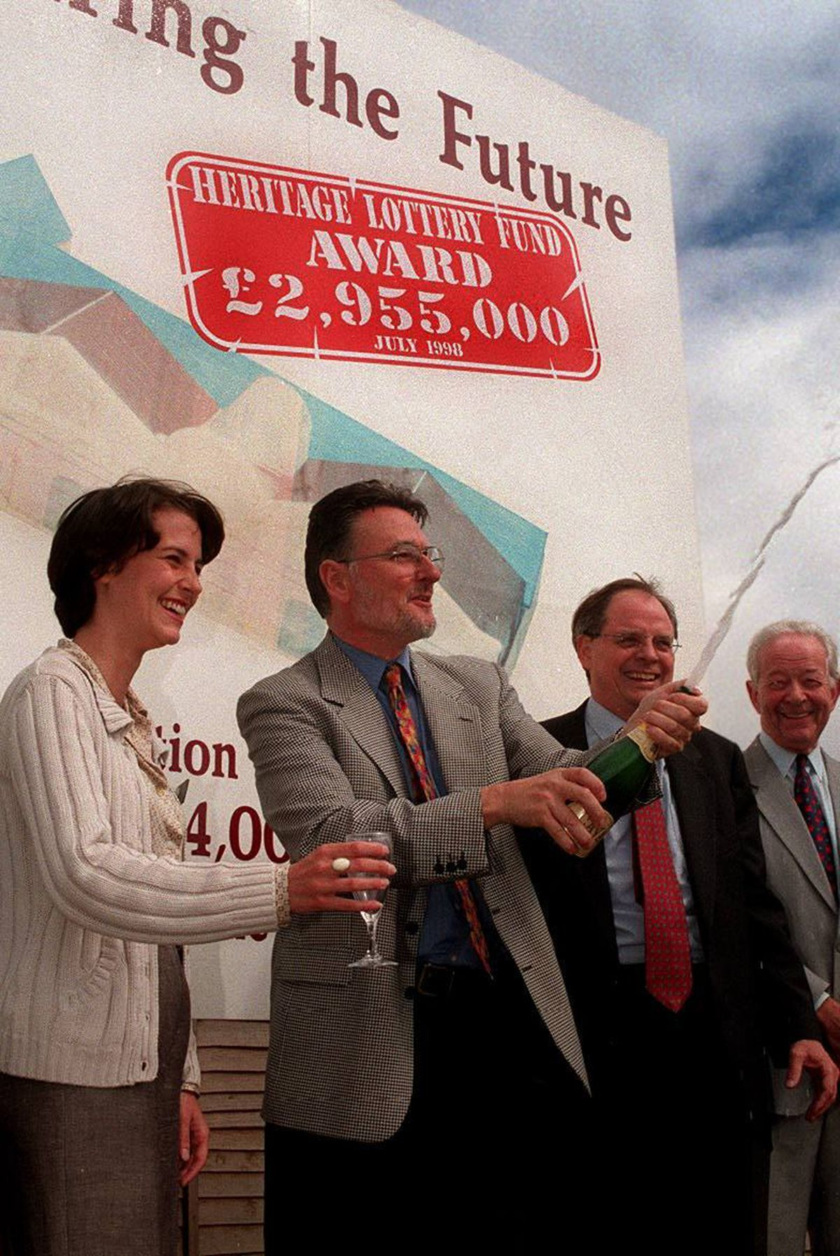 Ian Walden, then director of the Black Country Living Museum, pictured cracking open the champagne in 1998 after the attraction was awarded more than £2.9 million for the Rolfe Street baths project. He was pictured with Katie Norgrove of the National Lottery, then Dudley North MP Sir Ross Cranston, and Jack Russell