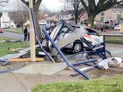 Car ploughs through bus stop and into tree in Coseley crash