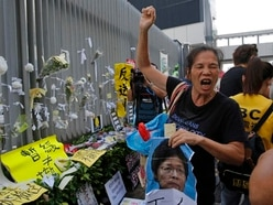 Hong Kong protesters reject leader's apology and demand she quit