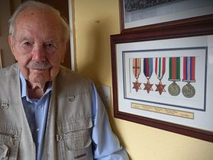 Cedric Parcell with his war medals