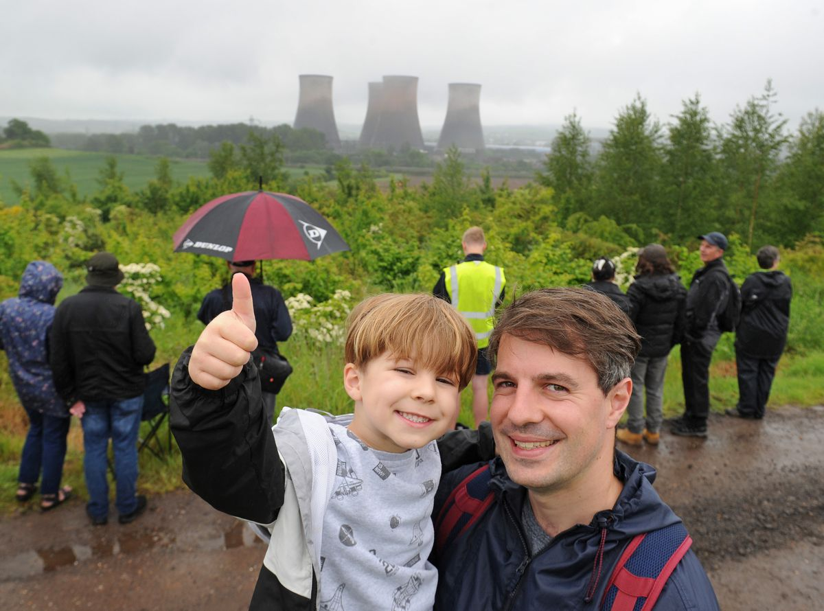 Alex Edwards, of Rugeley, and his son Theo Edwards, aged six, watched the demolition