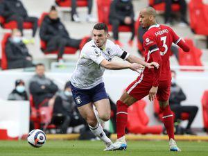 Aston Villa's John McGinn (left) and Liverpool's Fabinho