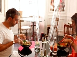 Europe's restaurants devise creative solutions to shield diners in pandemic era