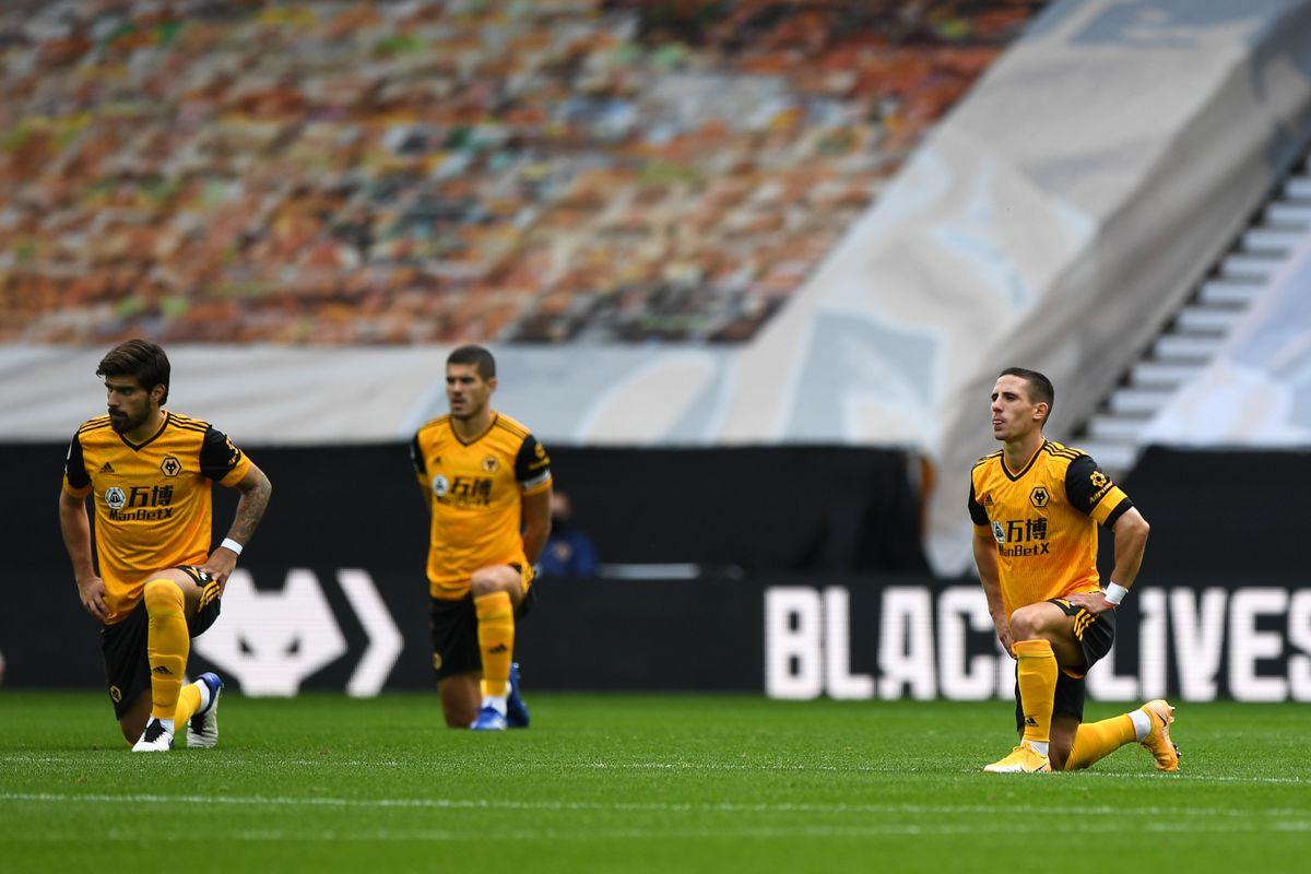 Ruben Neves of Wolverhampton Wanderers and Daniel Podence of Wolverhampton Wanderers take a knee. (AMA)