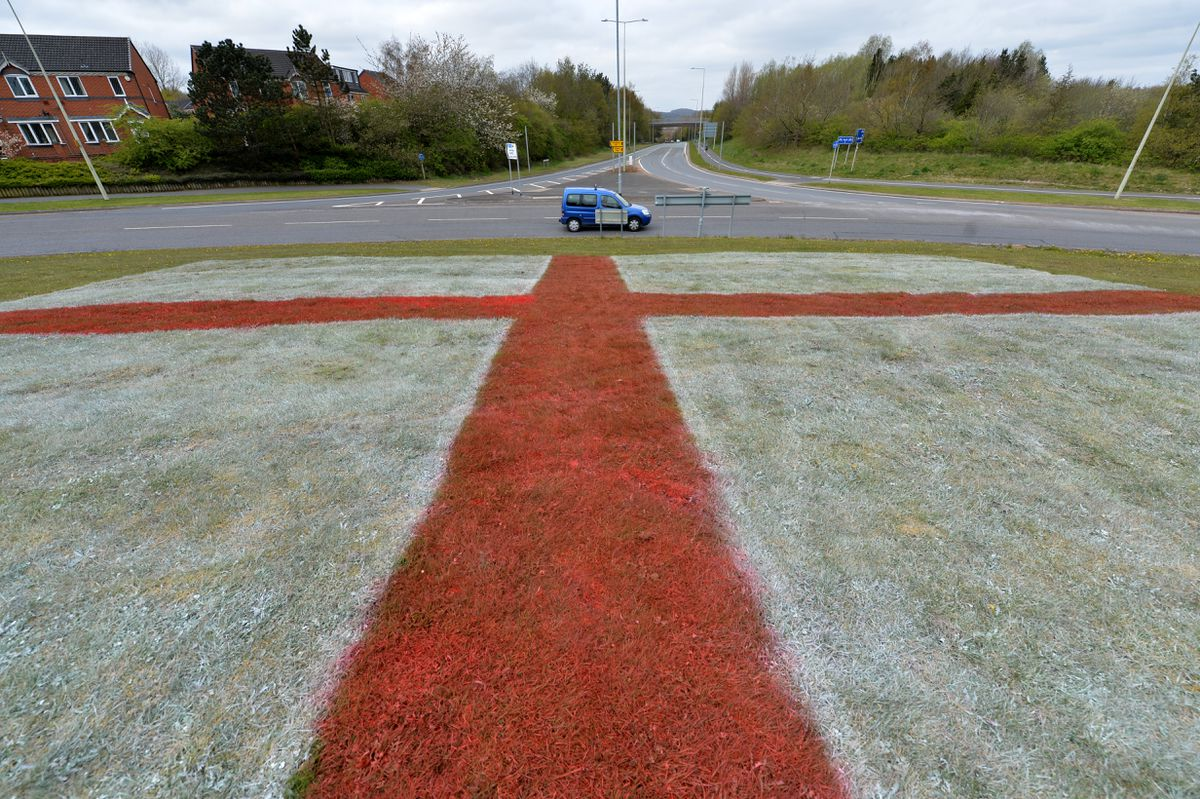 A St George's flag dyed into the grass in Telford