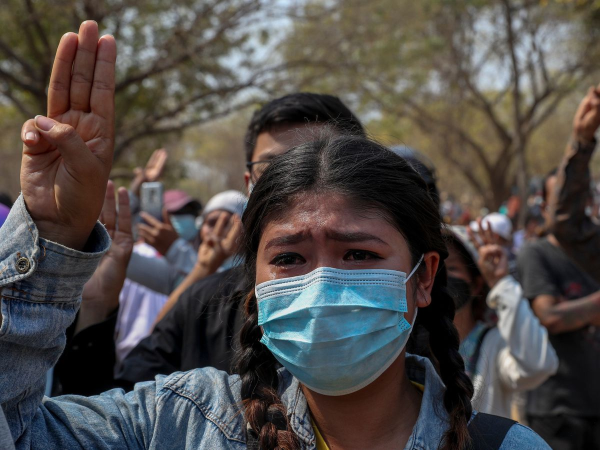 A woman cries during the burial of anti-coup protester Kyal Sin in Mandalay, Myanmar