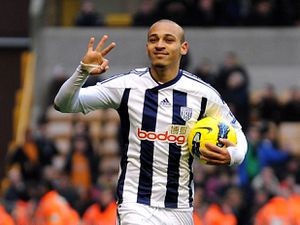 West Bromwich Albion's Peter Odemwingie celebrates completing his hat-trick and scoring his sides fifth goal during the Barclays Premier League match at the Molineux, Wolverhampton. PRESS ASSOCIATION Photo. Picture date: Sunday February 12, 2012. See PA story SOCCER Wolves. photo credit should read: Nigel French/PA Wire. RESTRICTIONS: Editorial use only. Maximum 45 images during a match. No video emulation or promotion as 'live'. No use in games, competitions, merchandise, betting or single club/player services. No use with unofficial audio, video, data, fixtures or club/league logos.