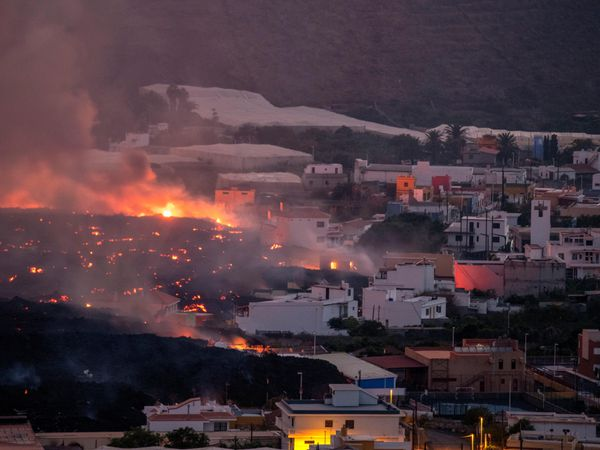 Lava flowing from a volcano destroys houses on La Palma